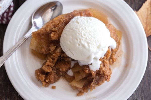 some apple crisp on a white plate
