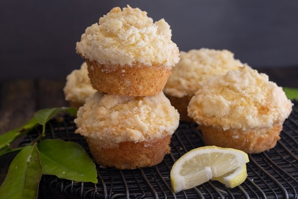 lemon muffins on a black wire rack with 2 stacked