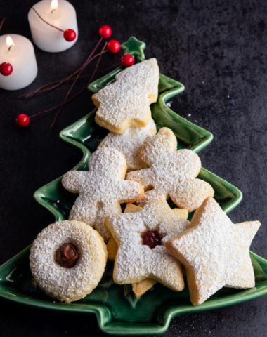 christmas cookies on a green christmas tree plate