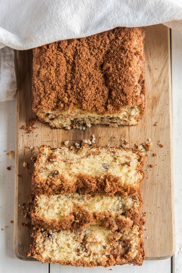 cinnamon raisin bread on a board with 3 slices cut