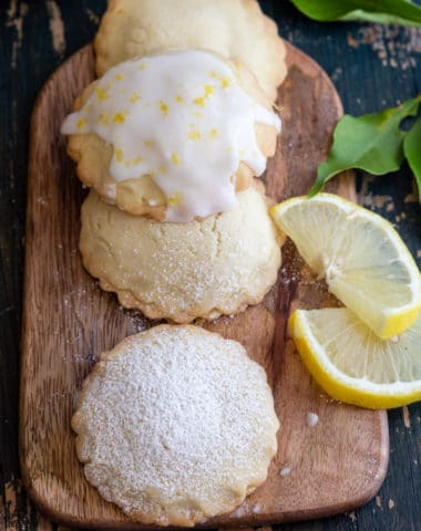 stuffed lemon cookies on a wooden board with lemon slices