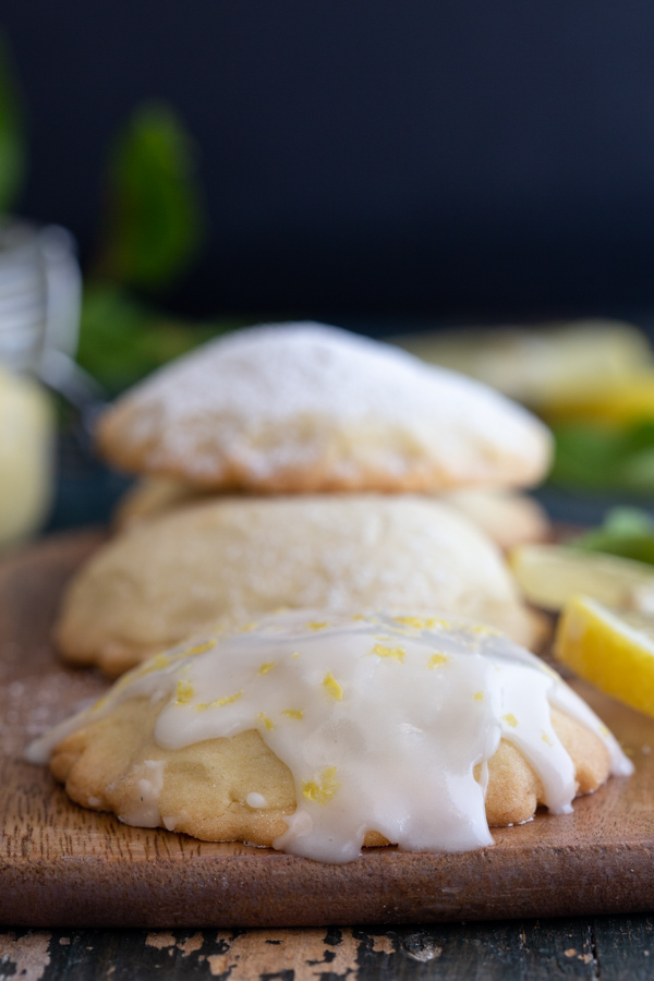 cookie with lemon glaze with more cookies in the background
