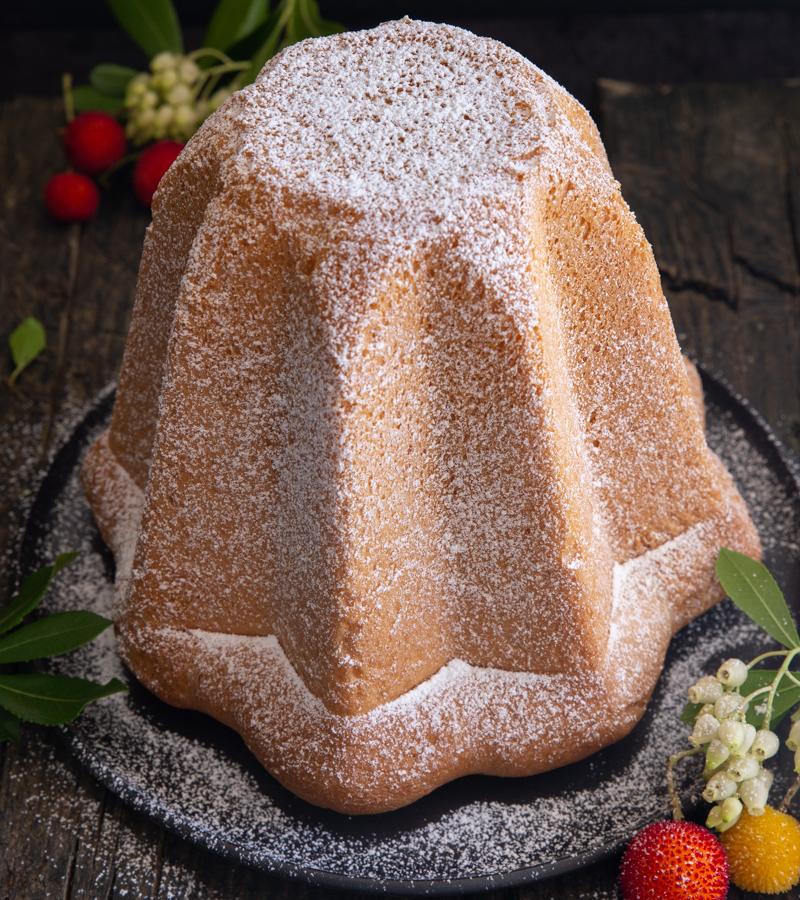 pandoro cake on a black plate