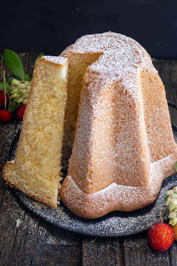 a slice cut from the pandoro cake