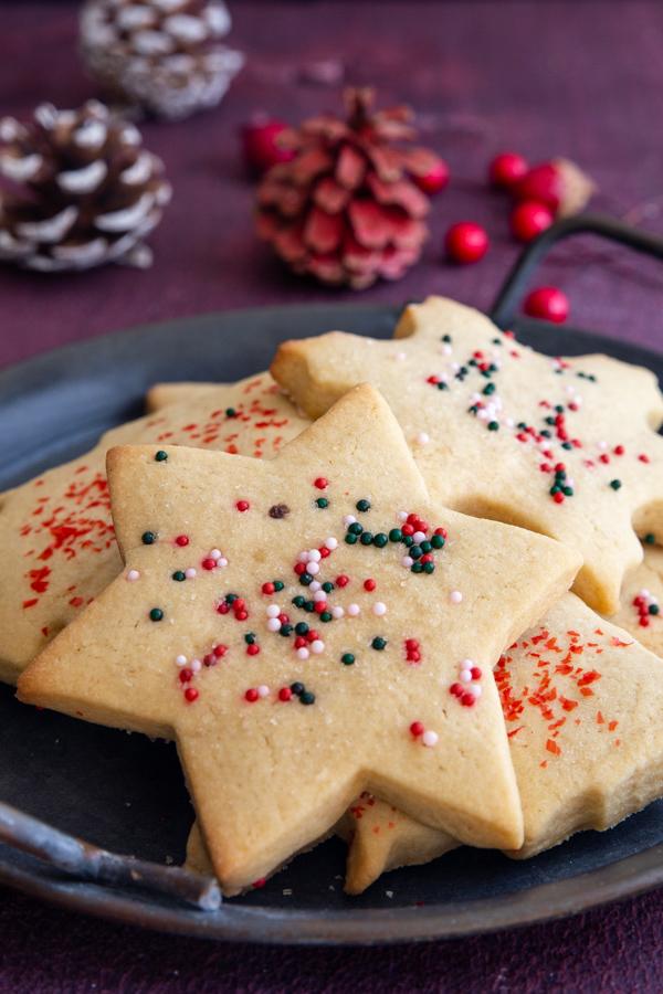 sugar cookies on a black plate