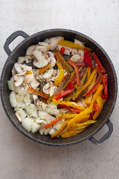 raw vegetables in a black pan