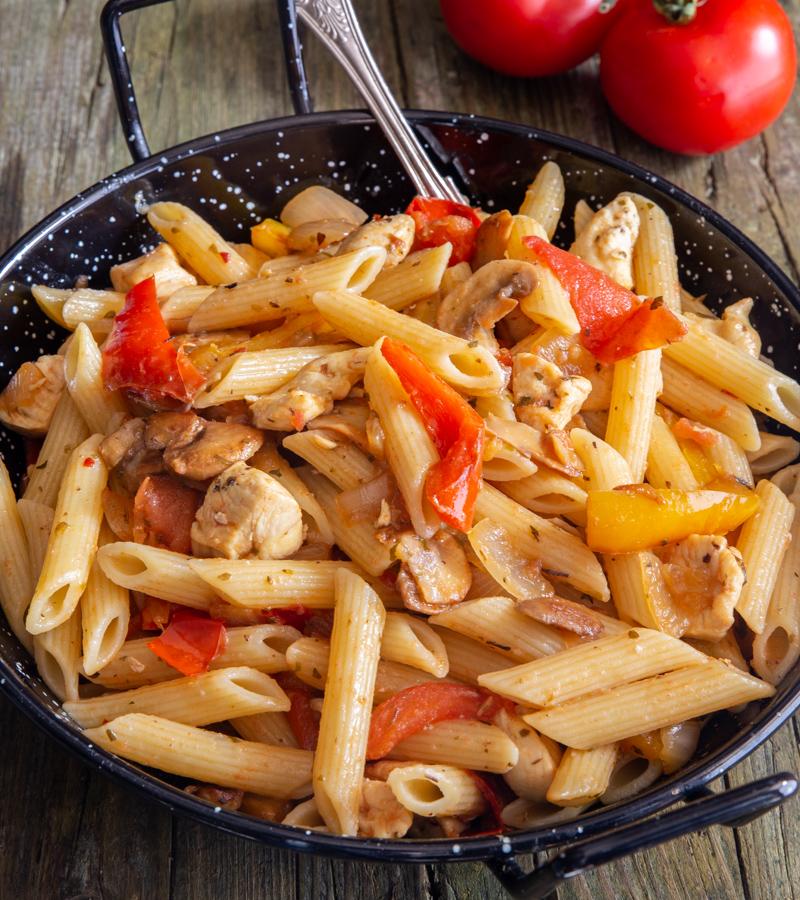 skillet turkey pasta in a black bowl