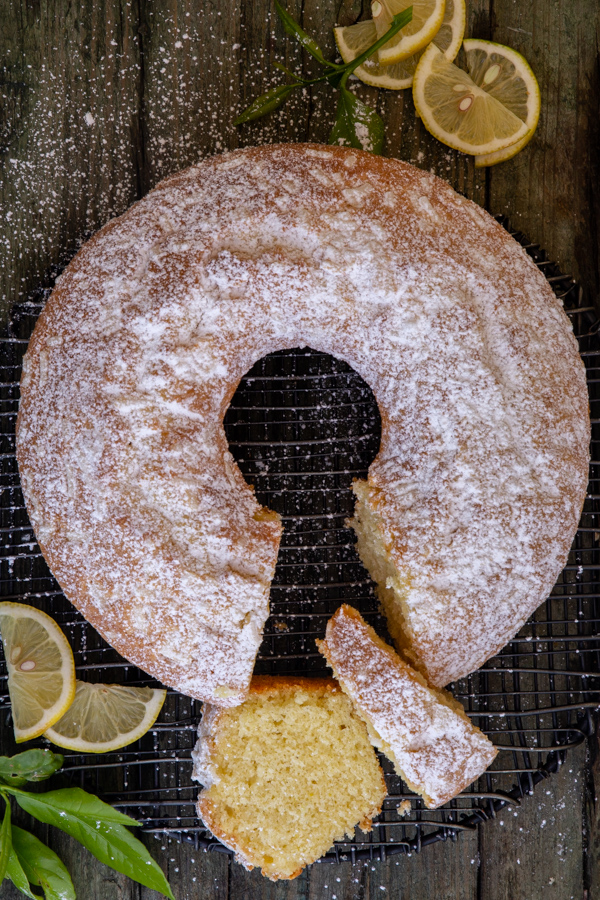 bundt cake on a wire rack with 2 slices cut