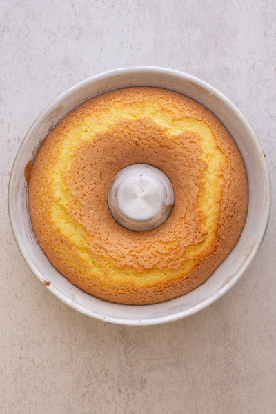 the baked cake in the bundt pan