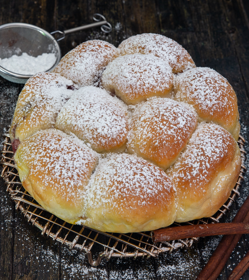 pull apart bread on a wire rack with powdered sugar