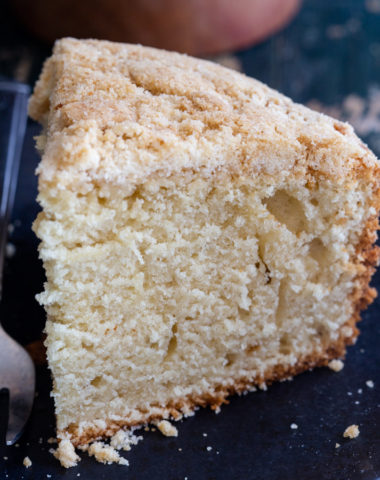crumb cake on a black plate