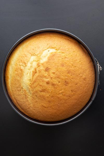 baked cake in black cake pan