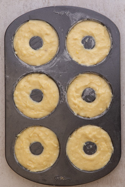 donuts in the donut pan before baking