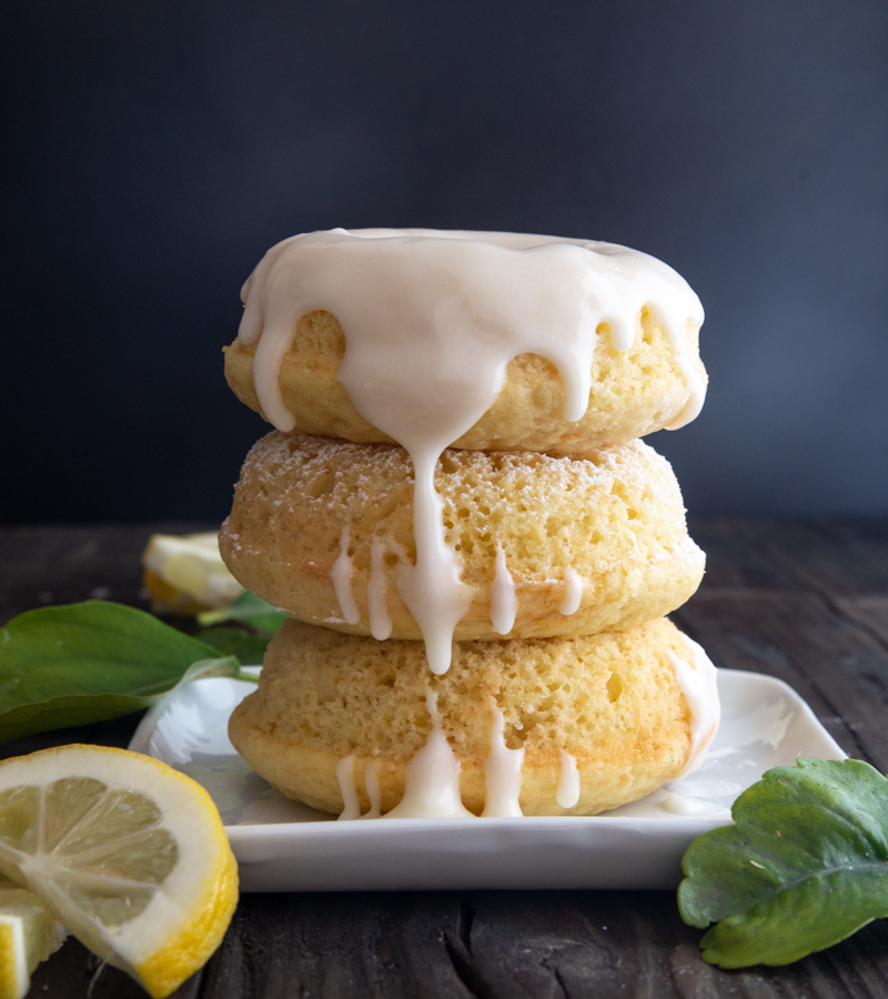 3 lemon donuts stacked with lemon glaze dripping down