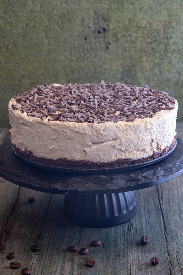 coffee cheesecake on a black cake stand