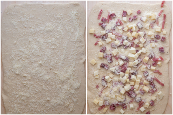 dough rolled into a rectangle and cheese & meat spread on top.