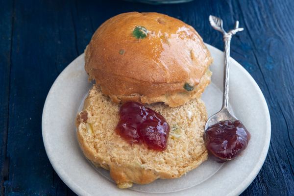 bun on a white plate with jam