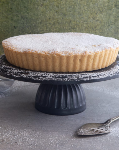 roman cake on a black cake stand