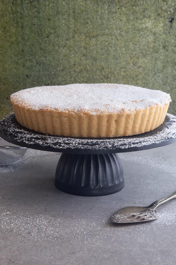 roman cake on a black stand