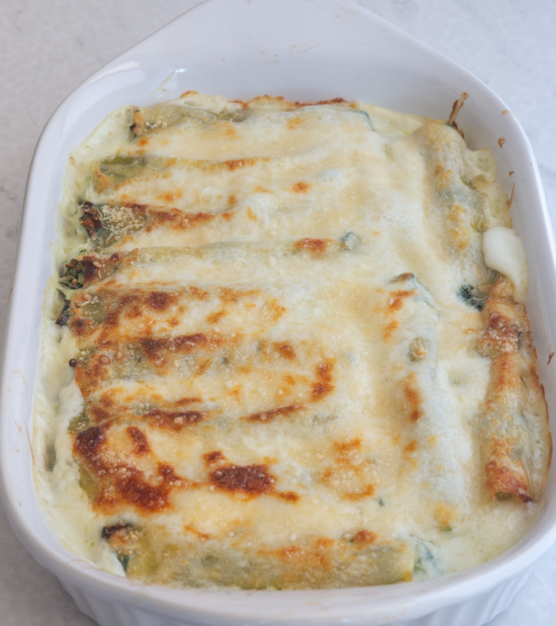 cannelloni in a white baking pan.