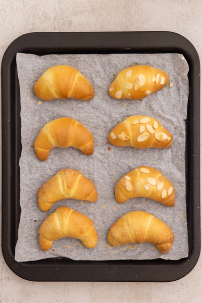 The baked crescents on a cookie sheet.