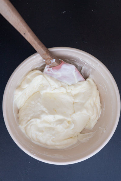 cream cheese and whipped cream mixed together in a white bowl.