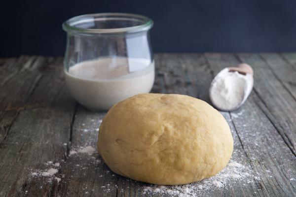 Dough on board with sourdough starter.