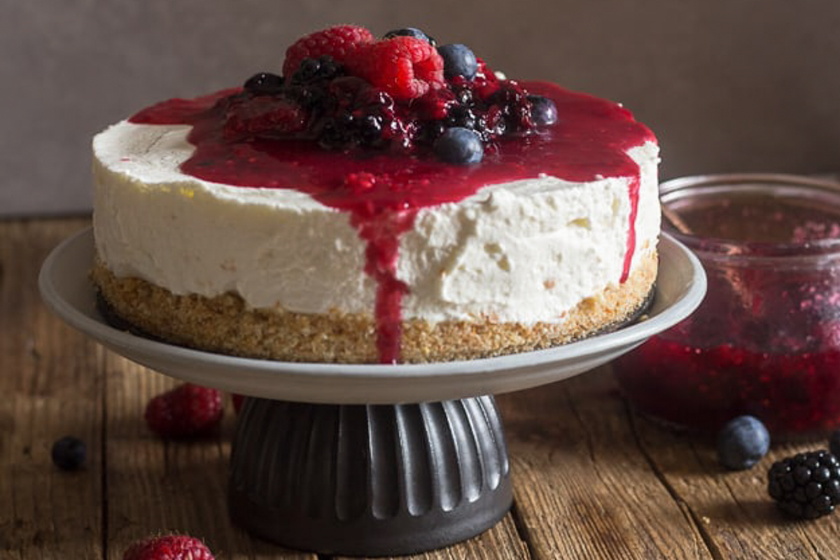 Cheesecake on a cake stand.