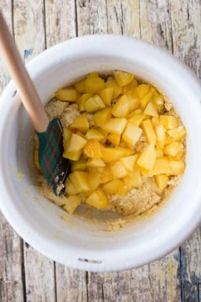 Combine the whisked with the wet ingredients then fold in the chopped peaches.