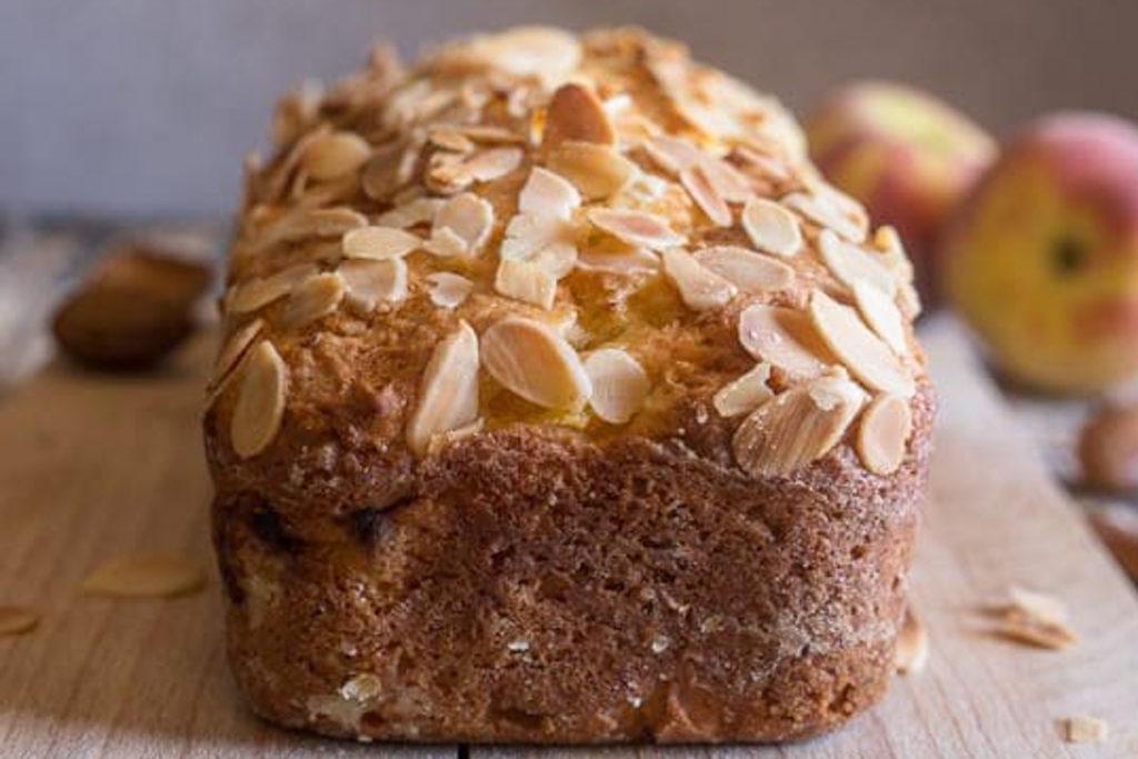 Baked peach bread on a wooden board.