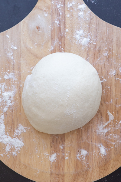 Dough shaped into a ball before first rise.
