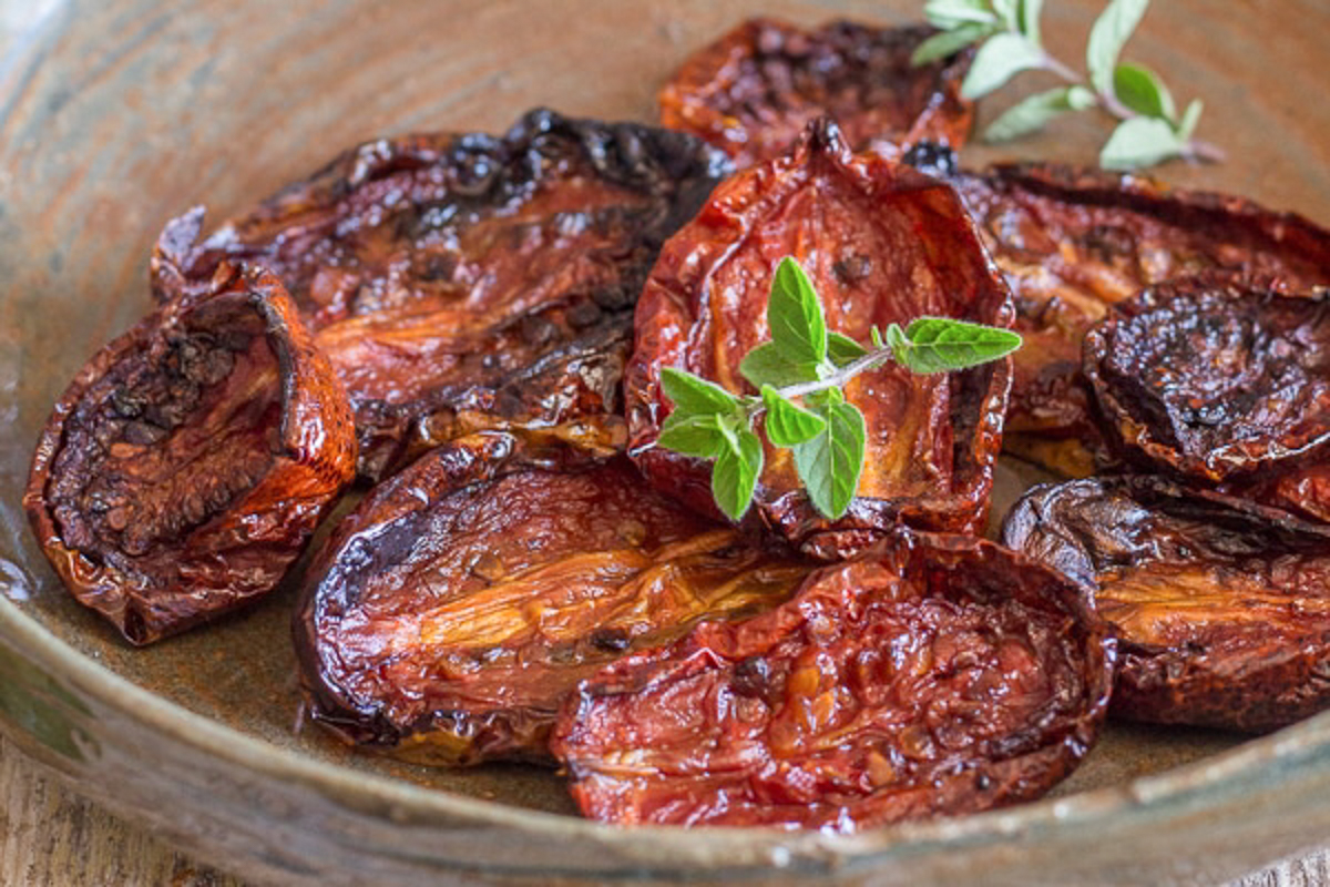 Sun-dried tomatoes in a brown dish.