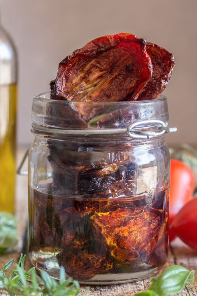 Sun dried tomatoes in a glass jar.