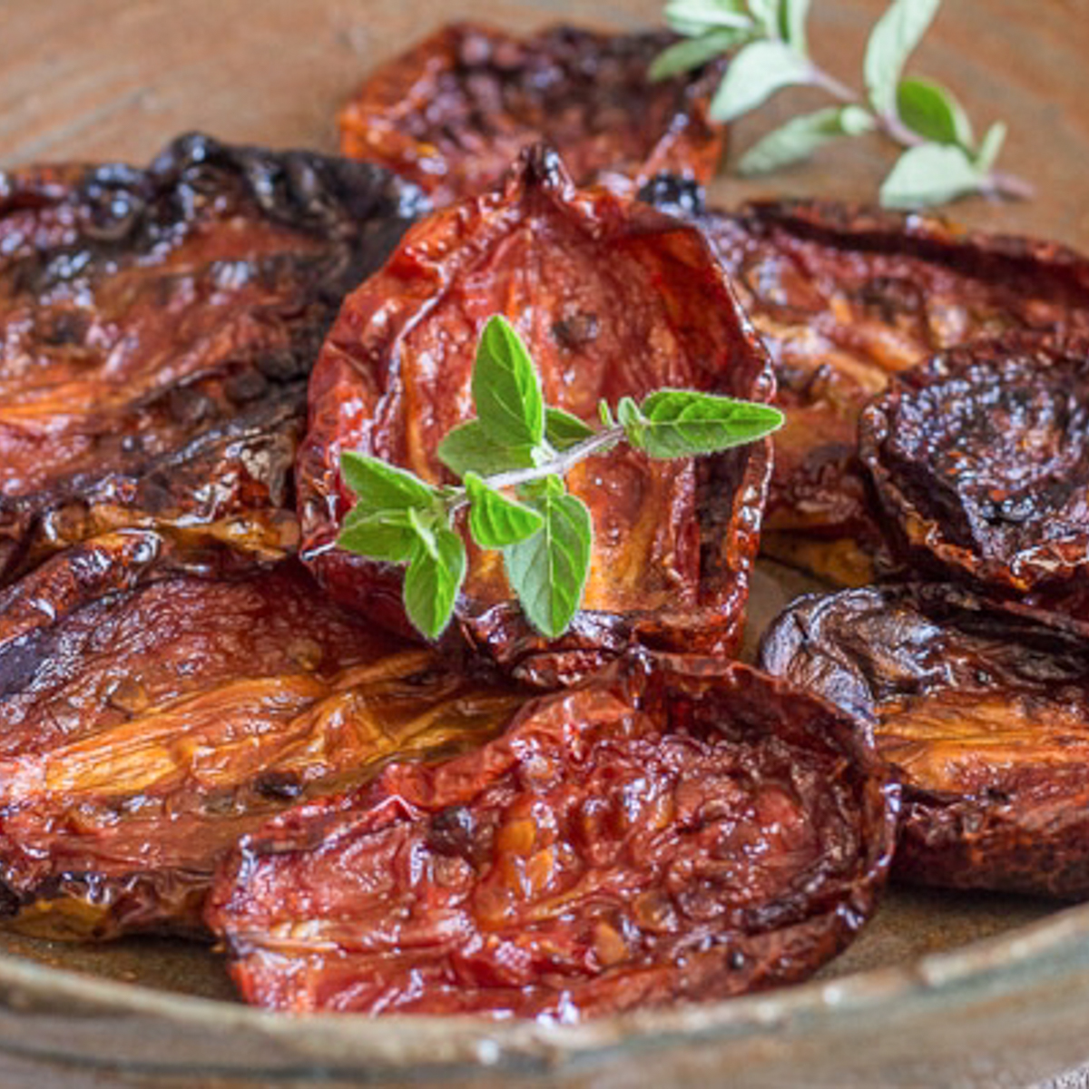 Sun- dried tomatoes in a brown plate.