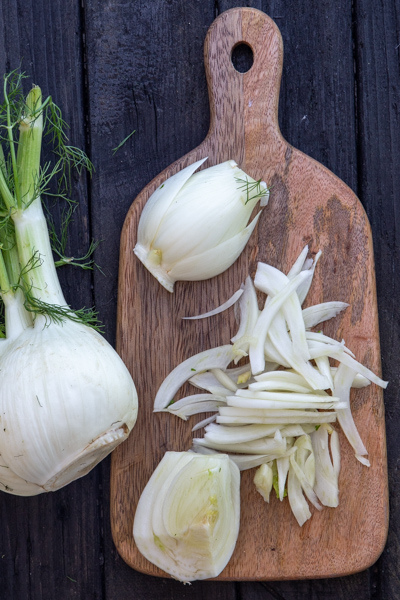 Slicked fennel on a clean board.