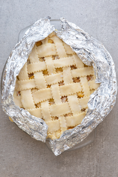 Wrapping the pastry edges with foil.