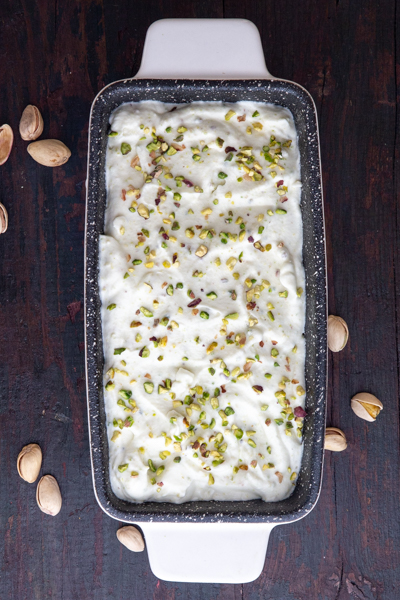 Pistachios sprinkled on the ice cream before freezing.