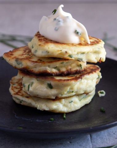 4 ricotta fritters stacked with a dollop of chive mayo.