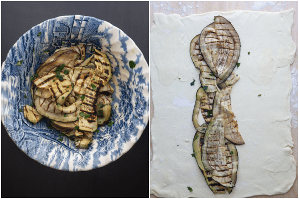 Grilled eggplant in a blue bowl and lined on the puff pastry.