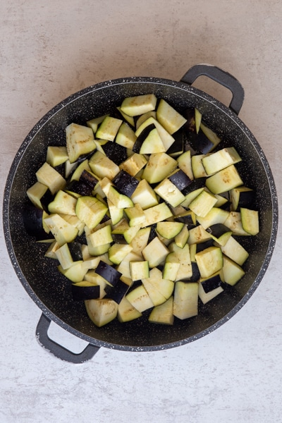 Eggplant in a pan before cooking.