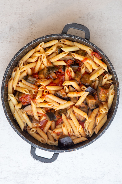 Pasta & water added to the pan with the tomatoes & eggplant.