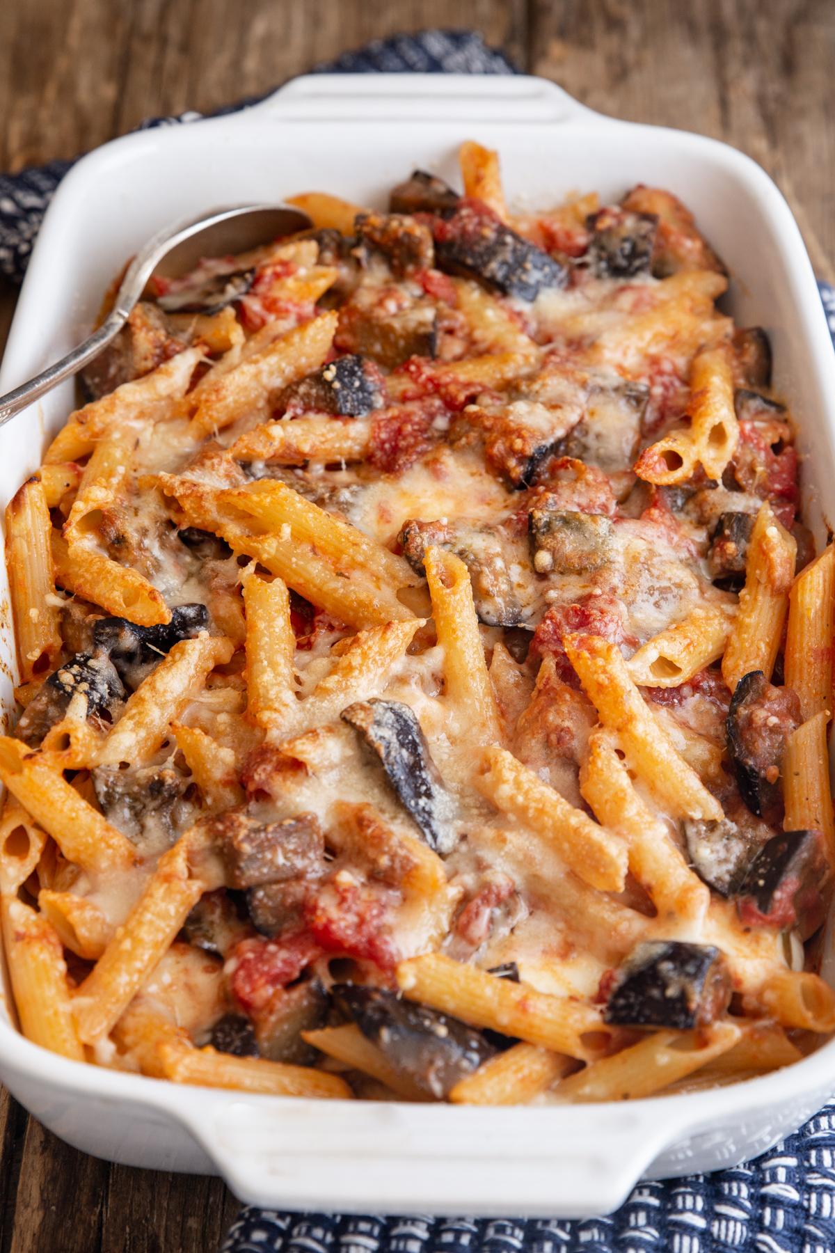 Sicilian pasta in a white baking dish.