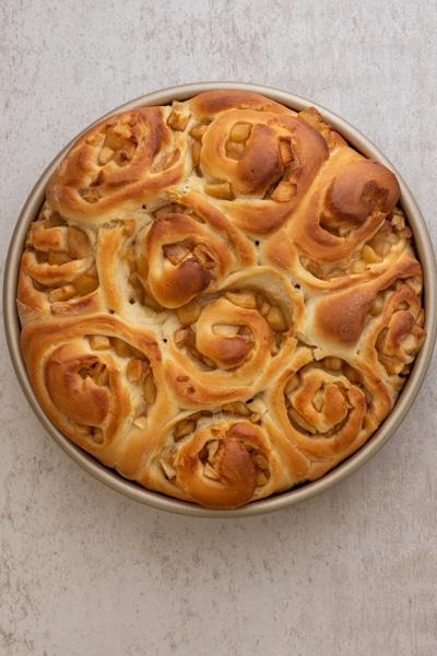 Caramel apple buns baked in a cake pan.