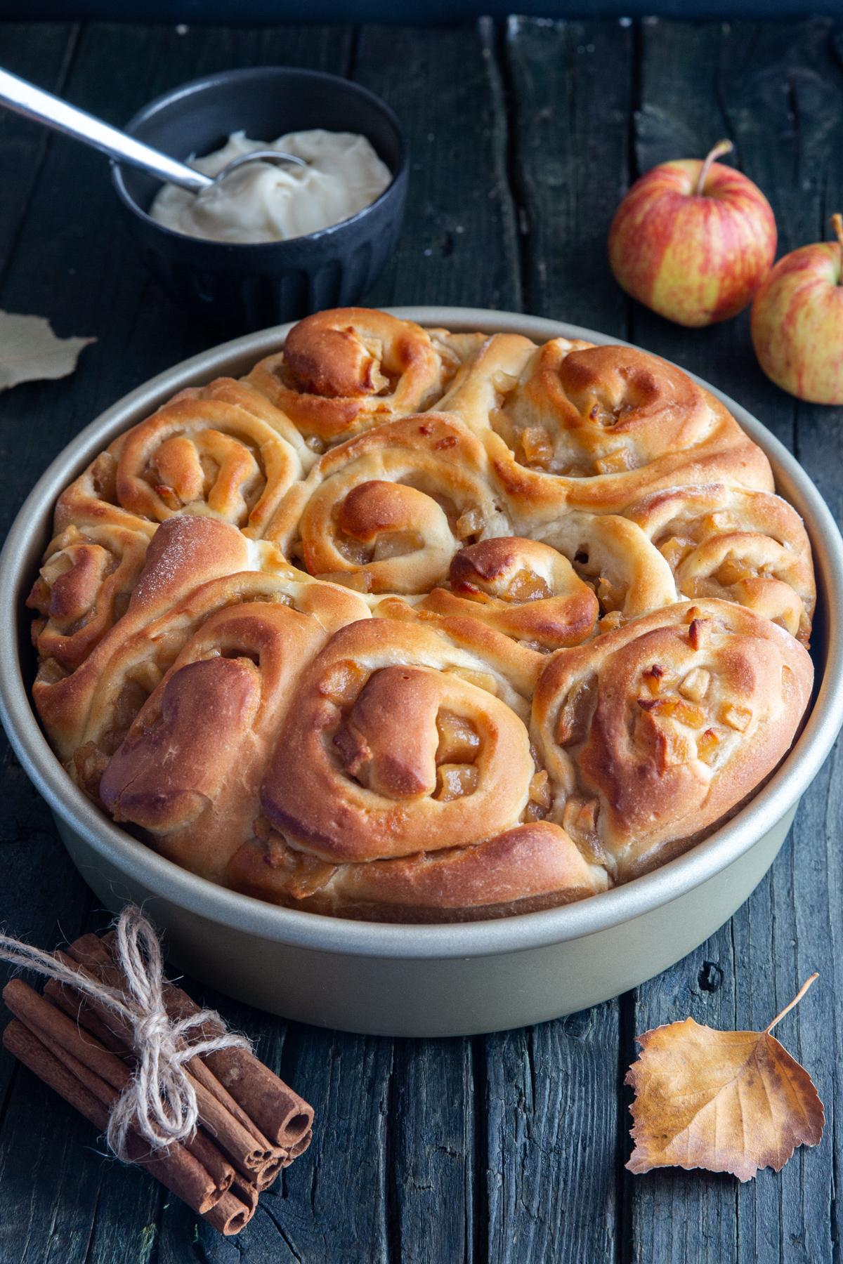 Cinnamon buns in a silver pan.
