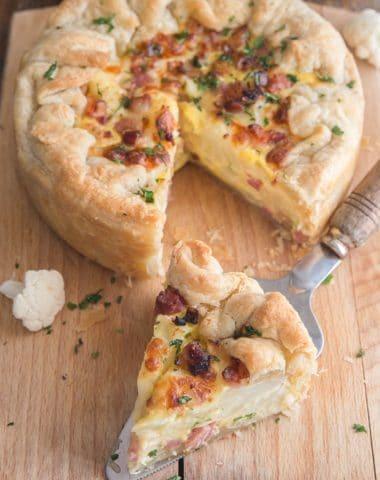 Cauliflower cheese pie on a wooden board.