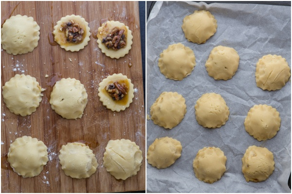 Adding the filling to the cookie rounds and covering with another round on a cookie sheet.