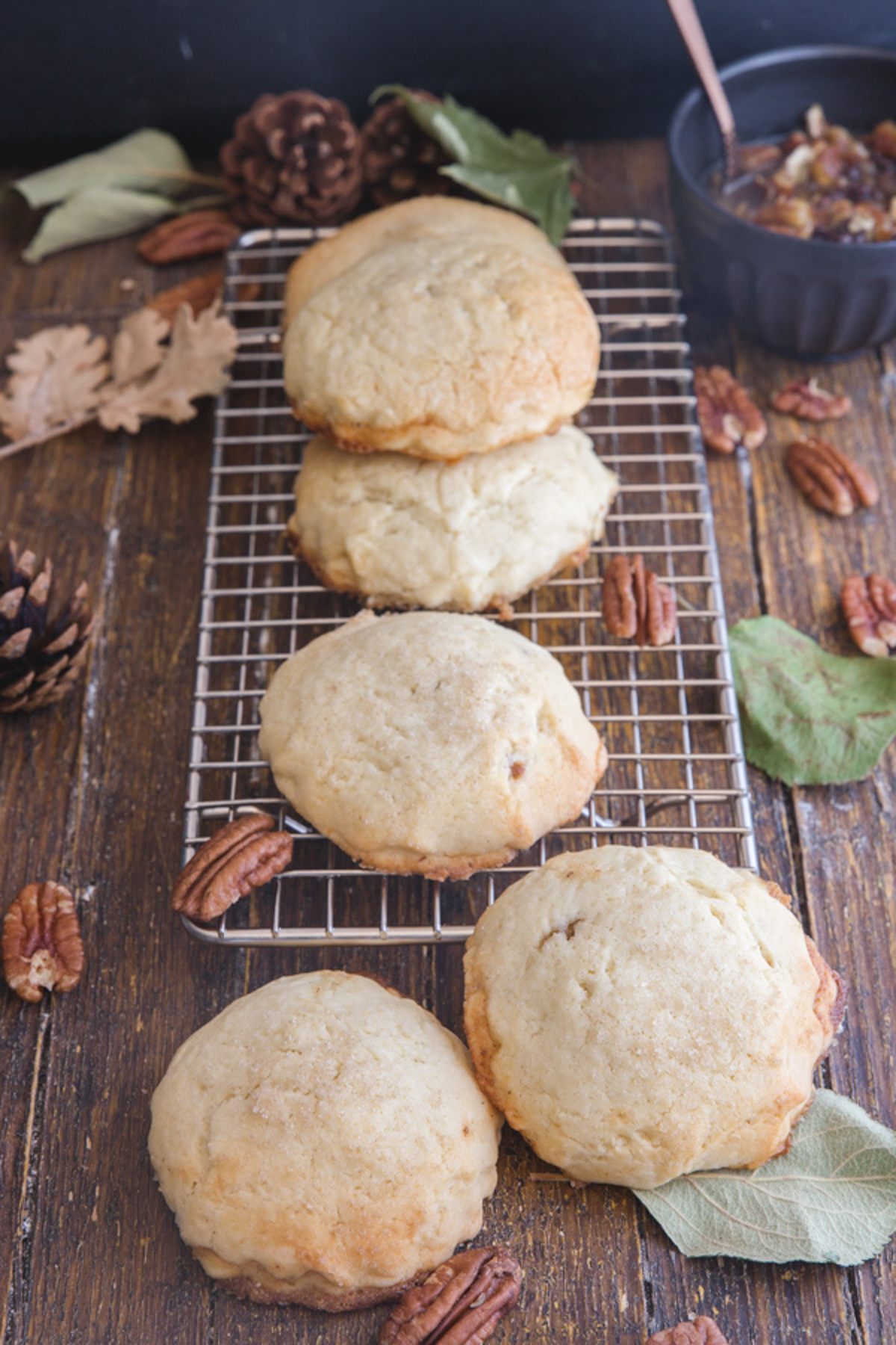 Pecan cookies on a wire rack.