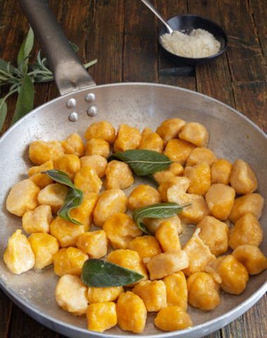 gnocchi in a silver pan with sage.