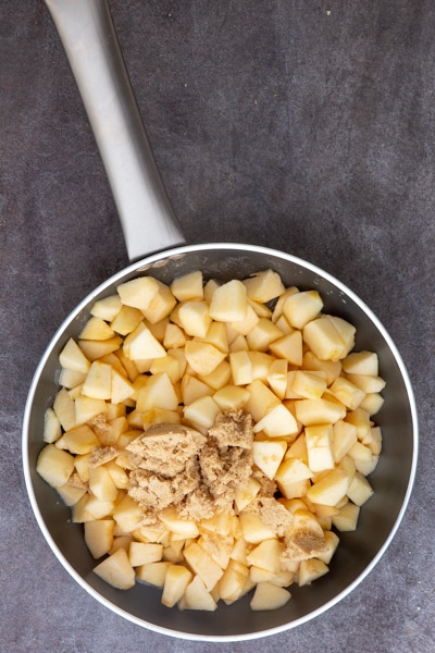 Chopped apples, water, butter & brown sugar in a frying pan.