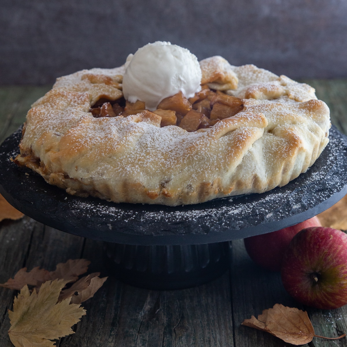 Apple galette with a scoop of ice cream on top.
